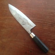 Deba with a san-mai blade steel ferrule and black bog oak. Cutting edge/ core is 1.2516.