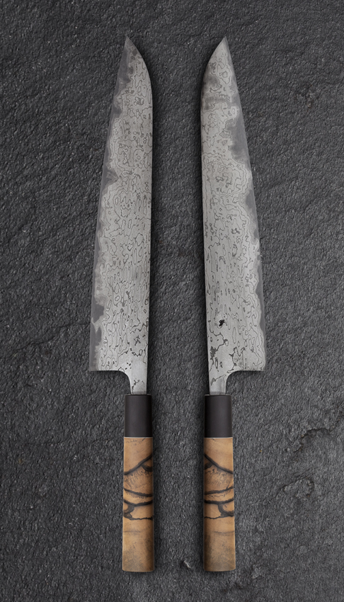Heart of Darkness is a Sujihiki type with an UHC damascus edged composite sanmai blade covered with a lower carbon damascus.