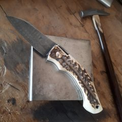 Unique friction folder with lock for Paul